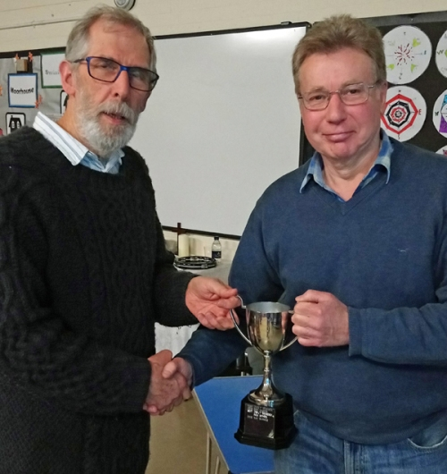 Chair Richard Hollingum (left) presents the cup to the winner of the Theme league - Ray Barnes